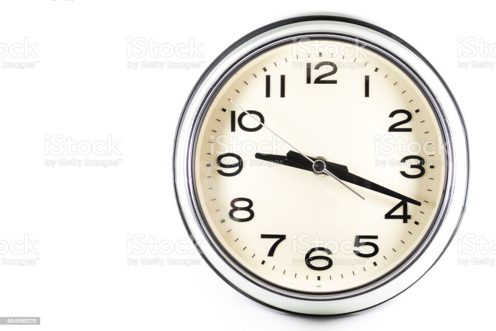 Isolated white background of vintage wall clock royalty-free stock photo