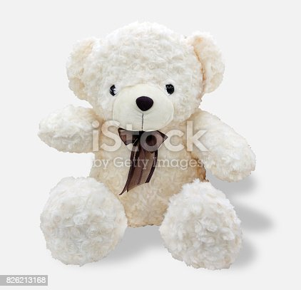 isolated white bear doll with bow tie ribbon on neck ; white background with clipping path on bear and shadow