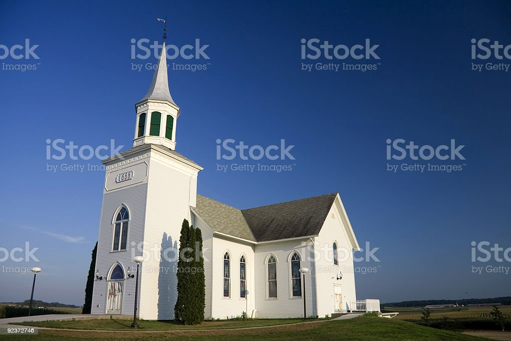 Isolated white church under a clear azure sky royalty-free stock photo