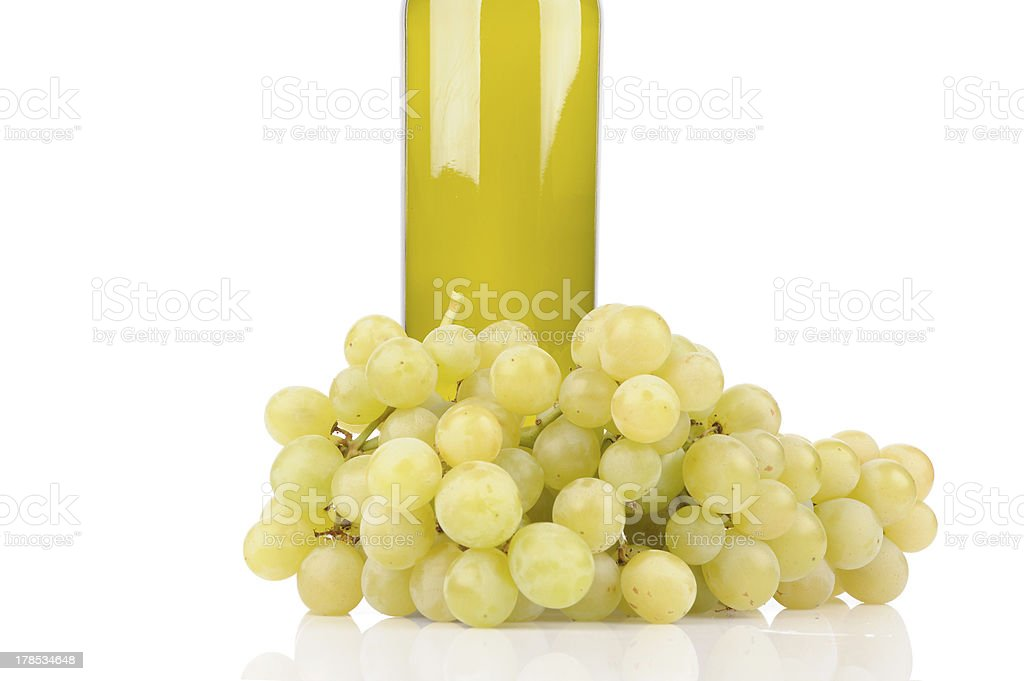 isolated wine bottle with green grapes royalty-free stock photo