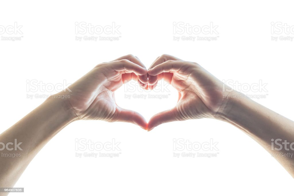 Isolated woman hands in heart shape on white background royalty-free stock photo