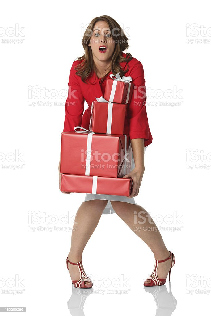 Isolated woman holding heavy presents royalty-free stock photo