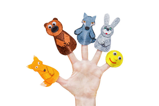 Isolated woman's hands with finger puppet Isolated female hands with fingers theatre puppets from the Russian folk tale