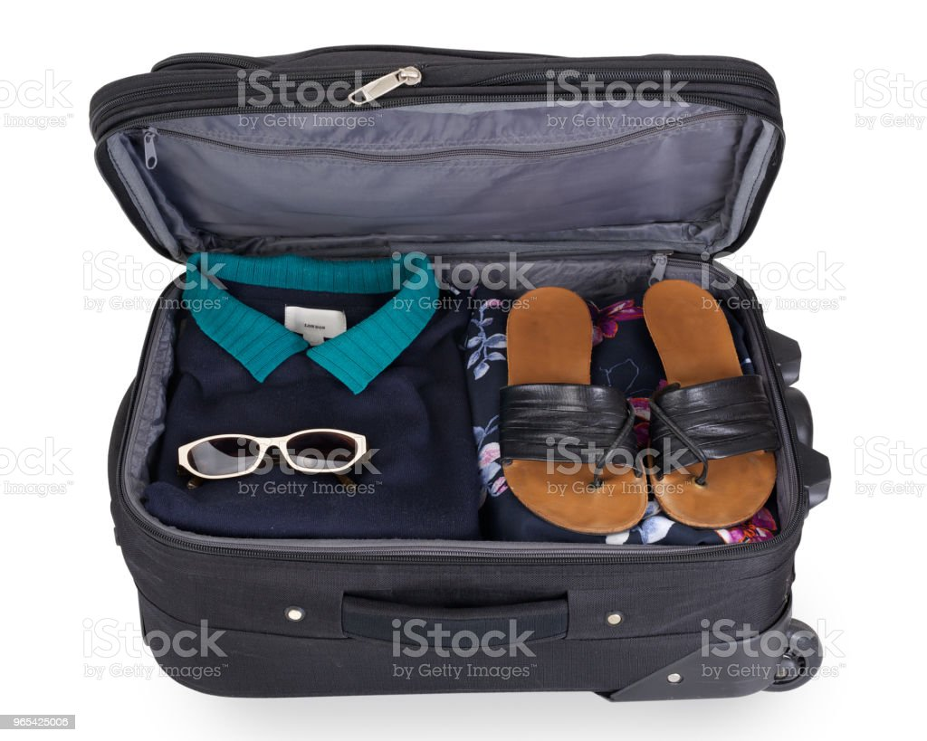 Isolated woman's suitcase for a short vacation or citytrip zbiór zdjęć royalty-free