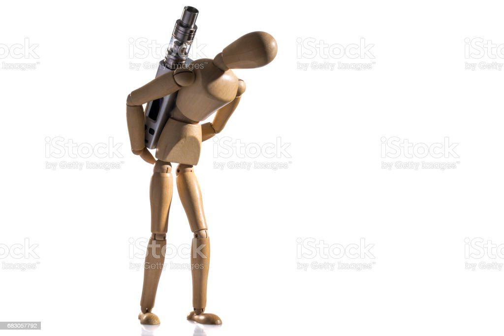 Isolated wooden dummy carrying e-cigarette. stock photo