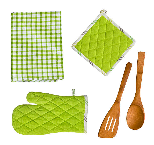 Isolated wooden kitchen utensils, glove, potholder and towel stock photo