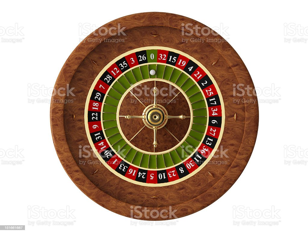 Isolated wooden roulette casino wheel with ball on green 0 stock photo