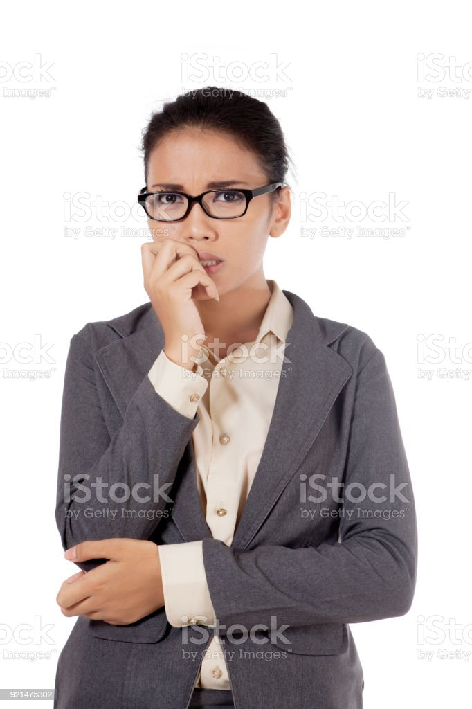 Isolated worried Asian woman posing over white background stock photo