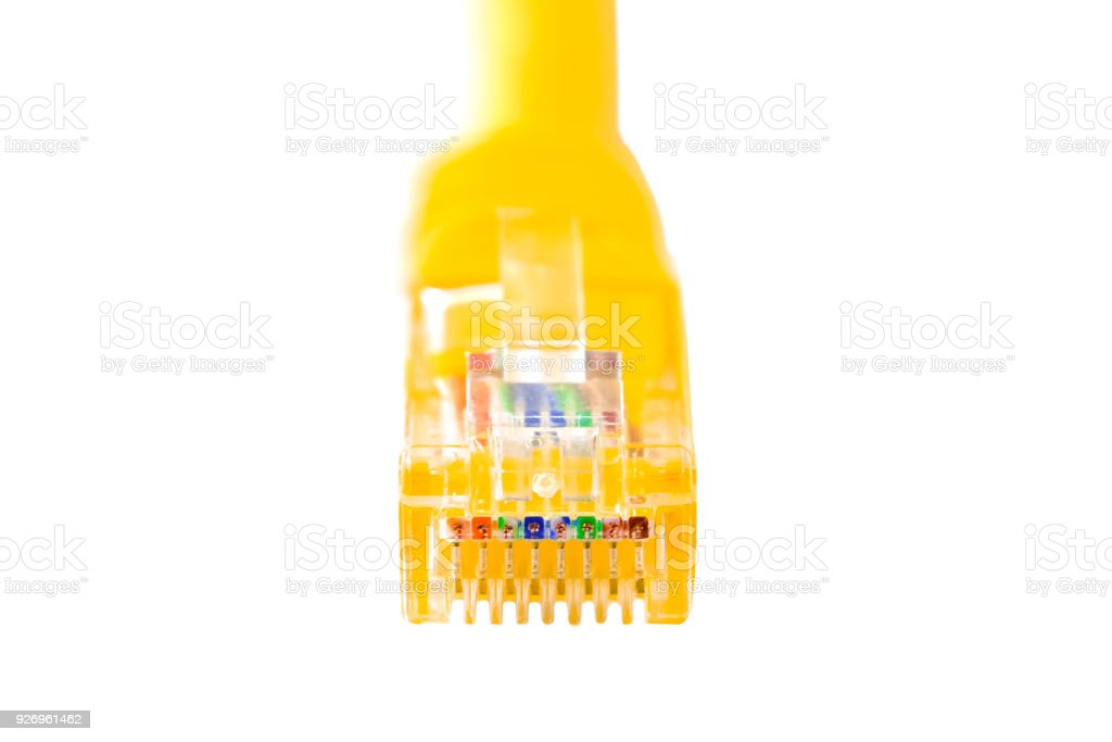 Isolated yellow cable head into (head rj45) for internet and communication,network,RJ45,plug. Close-up. stock photo