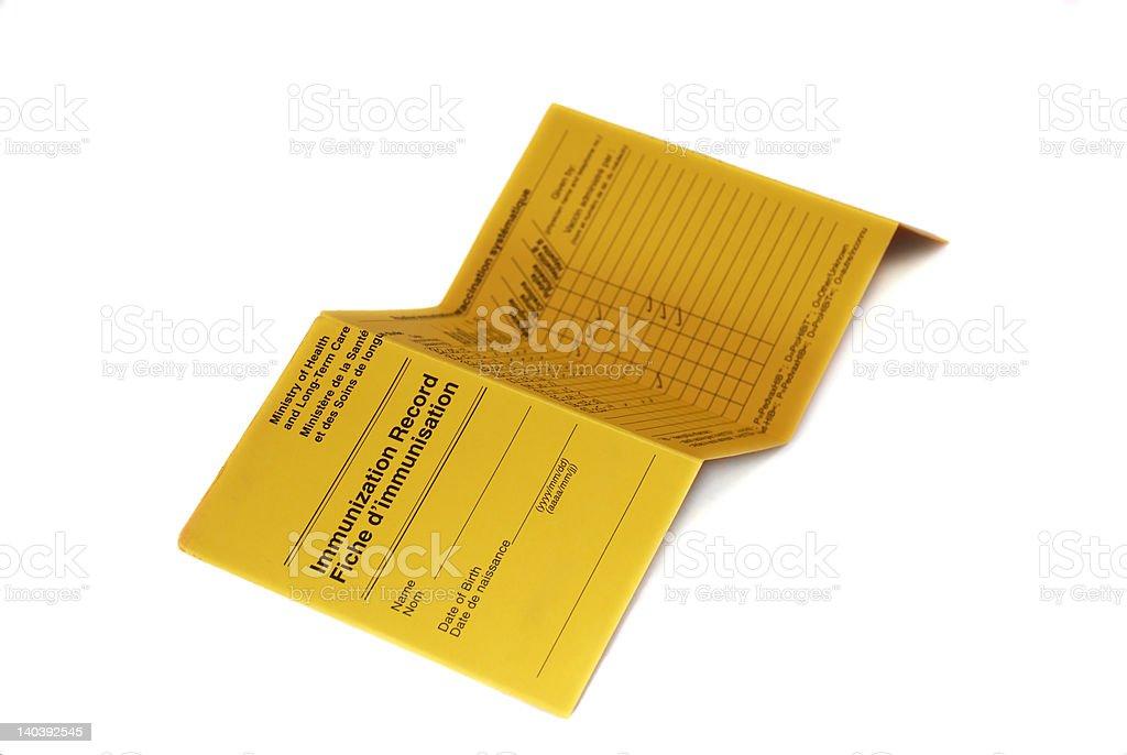 isolated yellow immunization record card stock photo