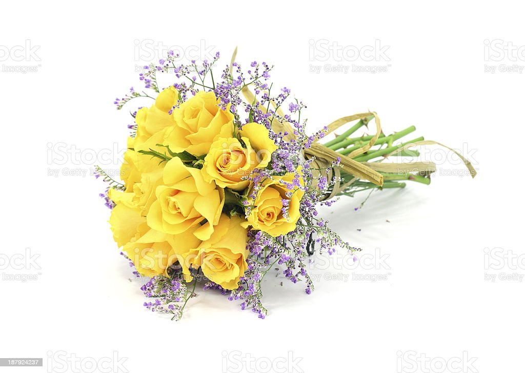 Isolated yellow rose bouquet , mauve foliage with a paper bow royalty-free stock photo