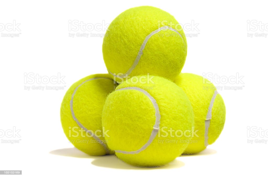 Isolated yellow tennis ball pyramid stock photo