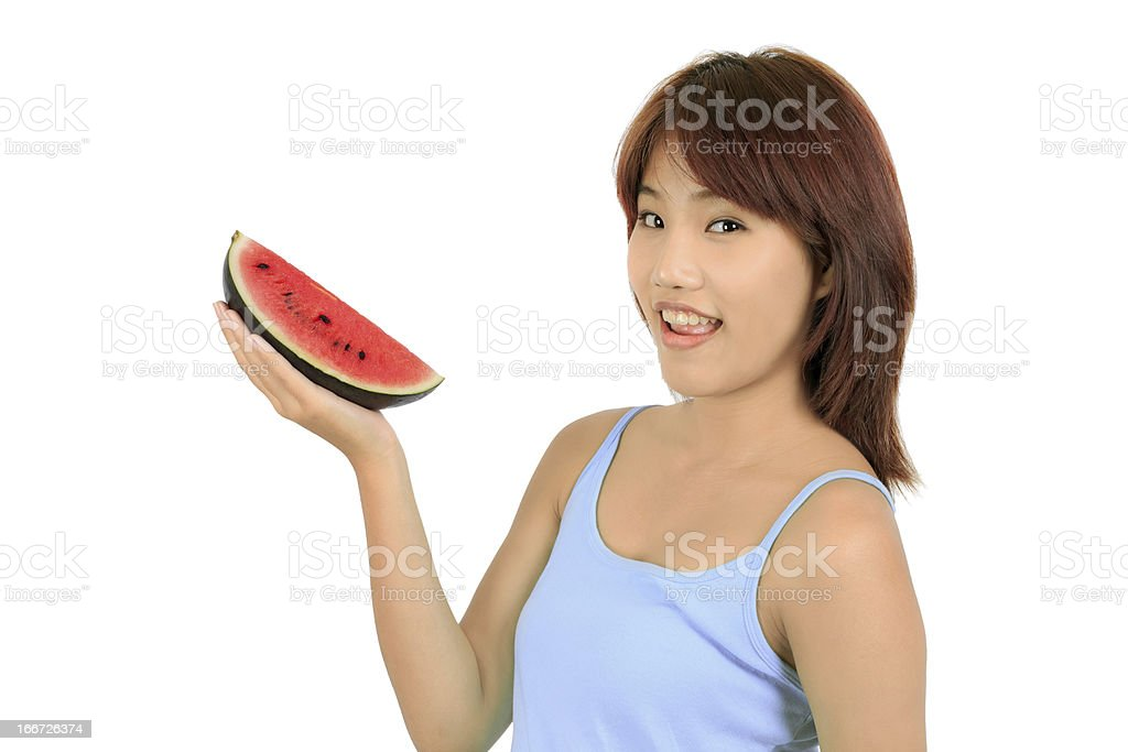 Isolated young asian woman with a piece of red watermelon royalty-free stock photo