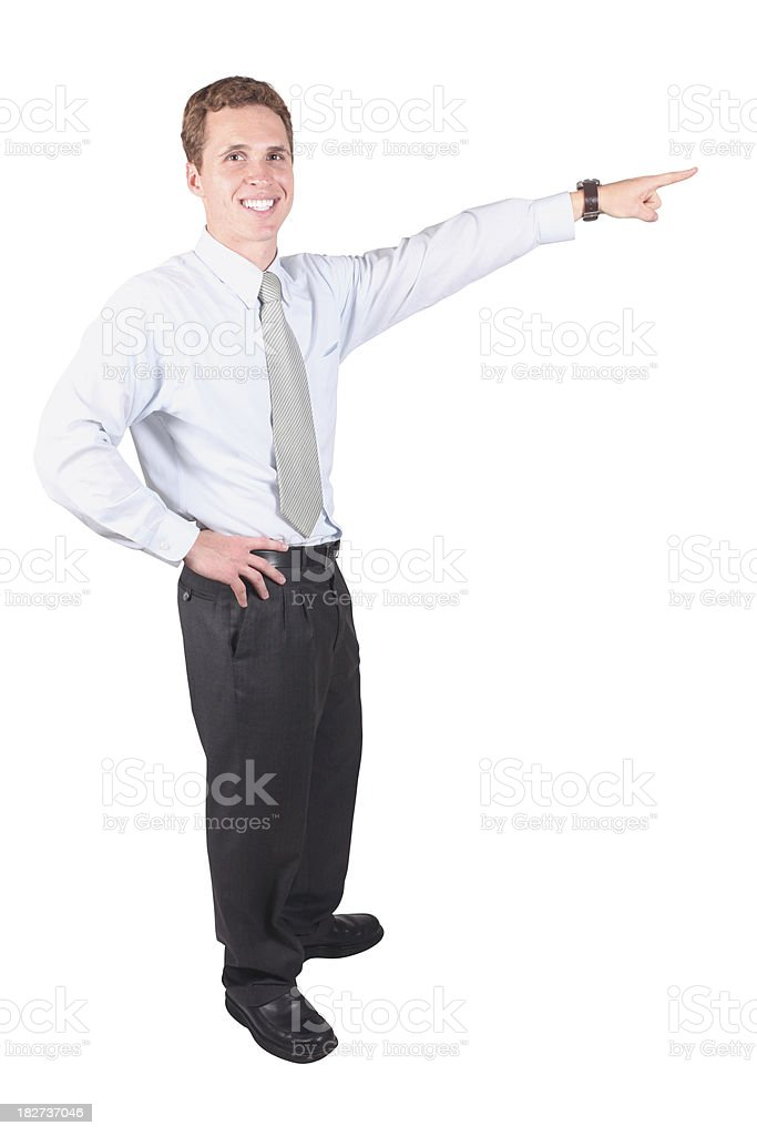 Isolated young businessman hand on hip pointing royalty-free stock photo