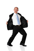 Isolated young businessman holding open his jacket