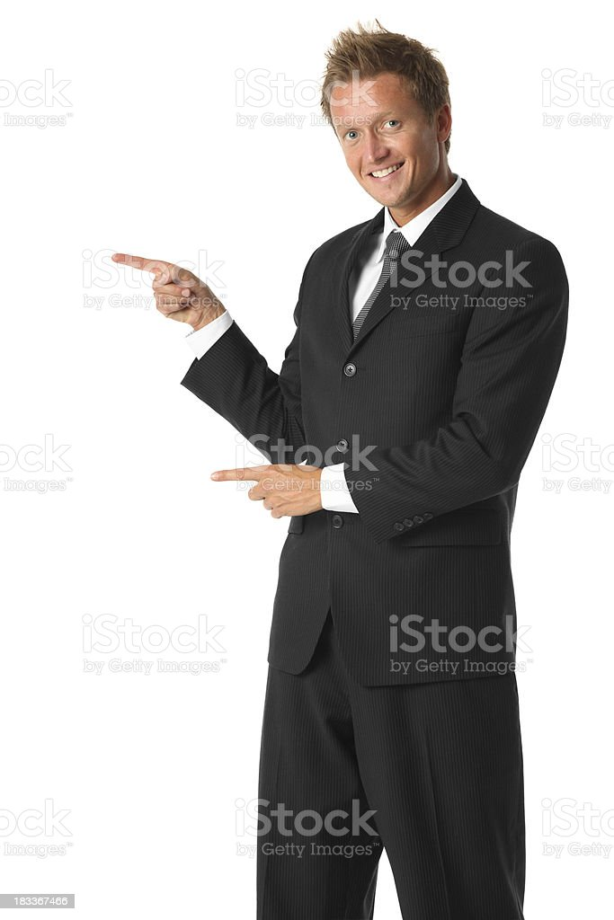 Isolated young businessman pointing to the side royalty-free stock photo