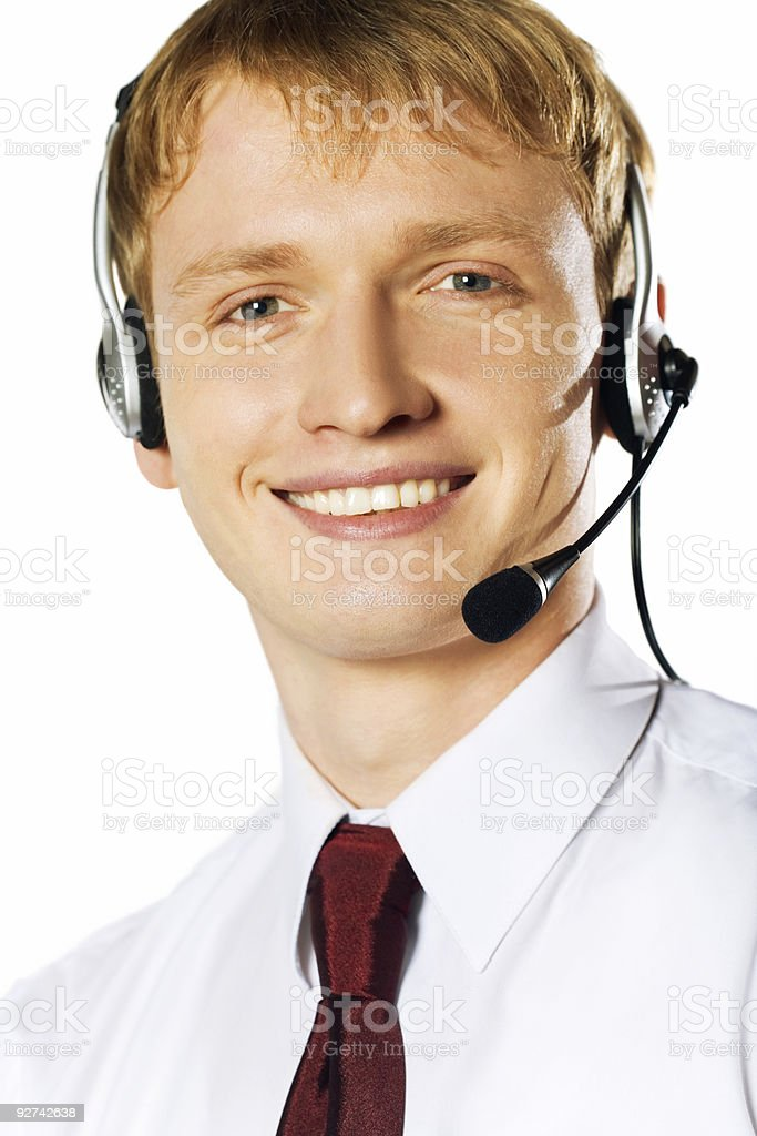 Isoliert junge lächelnd Geschäftsmann mit headset Lizenzfreies stock-foto
