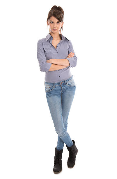 Isolated young woman in blue jeans and full body length. stock photo