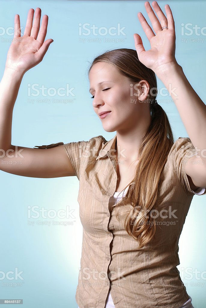 isolated young woman lifting hands in praise royalty-free stock photo