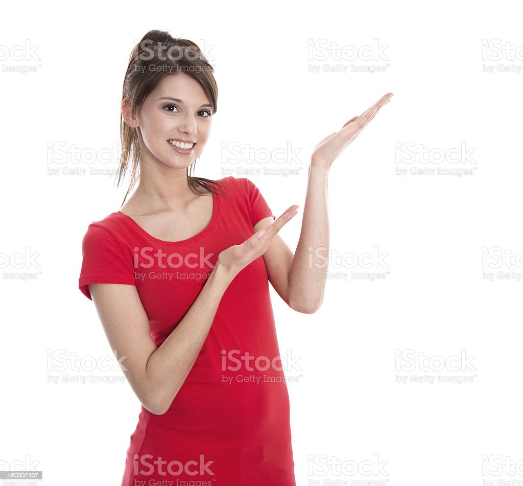 Isolated young woman presenting in a red shirt. stock photo