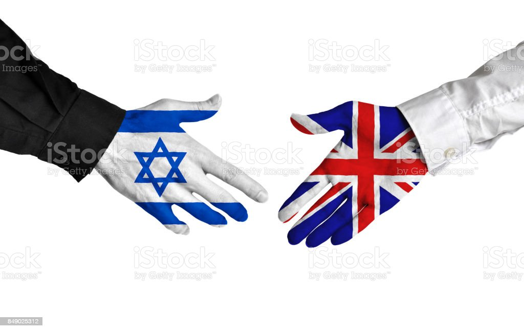 Israel and United Kingdom diplomats shaking hands for political relations stock photo