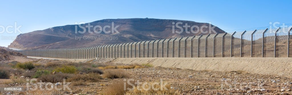 Israel Egypt border fence in the Negev and Sinai deserts stock photo