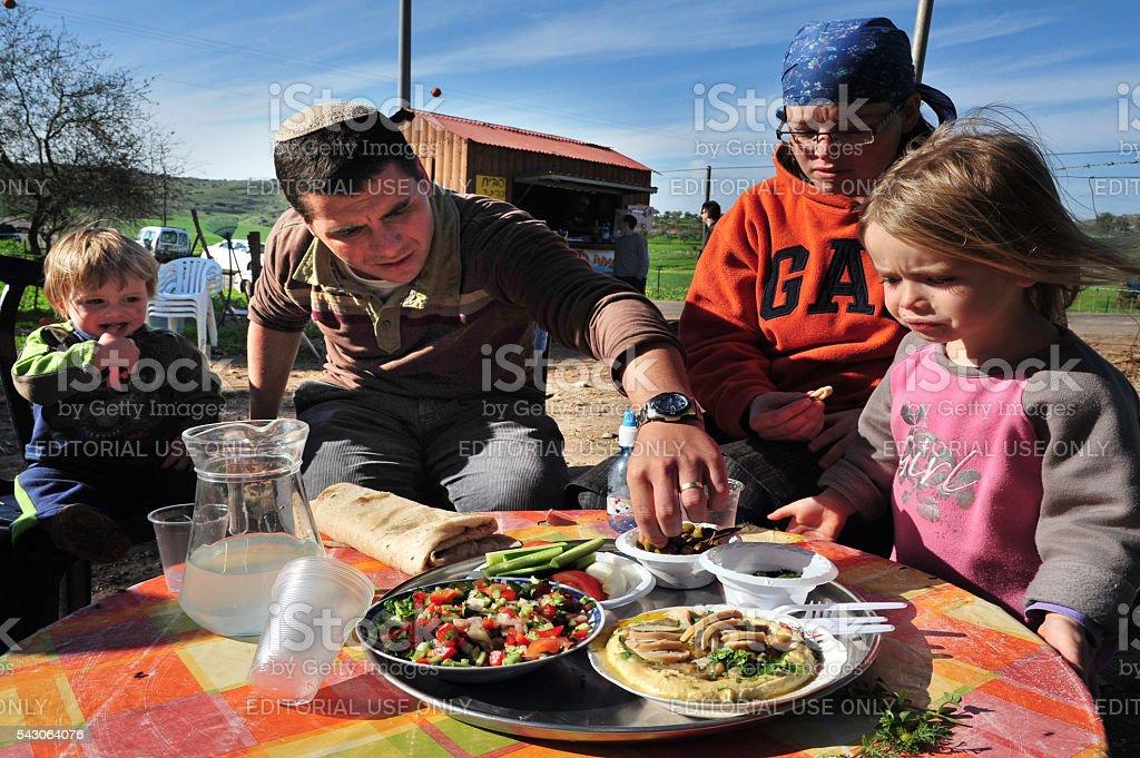 Israel family eats Hummus stock photo