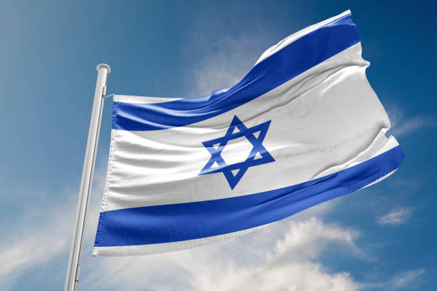 Israel Flag is Waving Against Blue Sky stock photo