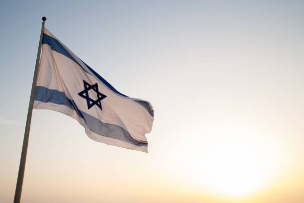 Israel Flag A Flag of Israel on Masada judaism stock pictures, royalty-free photos & images