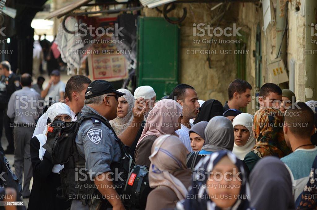 Israeli Border Policeman Arguing With Muslim Demonstrators stock photo