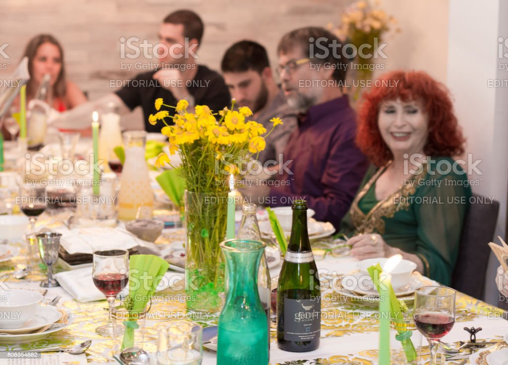 Israeli family in a Passover Seder dinner stock photo