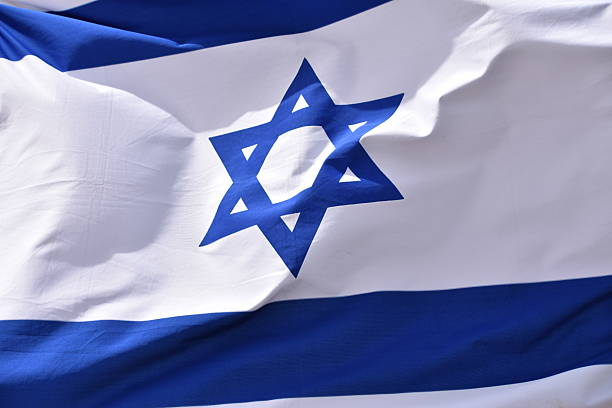 Israeli flag in  wind stock photo
