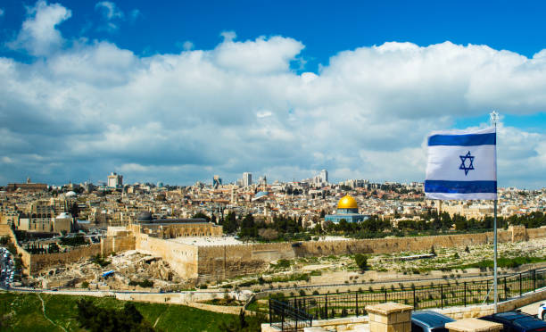 Israeli flag, Jerusalem Israeli flag flying over Jerusalem and the Temple Mount jerusalem old city stock pictures, royalty-free photos & images