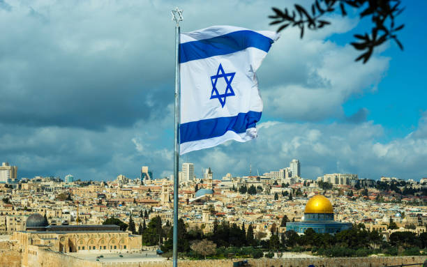Israeli flag, Jerusalem Israeli flag flying over Jerusalem and the Temple Mount east jerusalem stock pictures, royalty-free photos & images