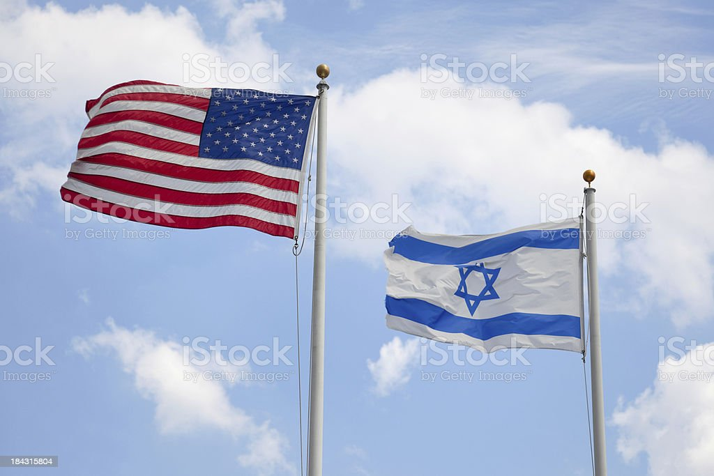 USA & Israeli Flags United States & Israeli flags wave together in unison symbolizing concepts such as the American/Israeli bond and Judaism in America. Here are some related images: American Culture Stock Photo