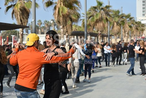 Tel Aviv, Israel – January 05, 2019; unidentified people dancing at the weekly Israeli Folk Dancing at Gordon Beach Promenade in Tel Aviv from 11:00 a.m. until 14:00 p.m.