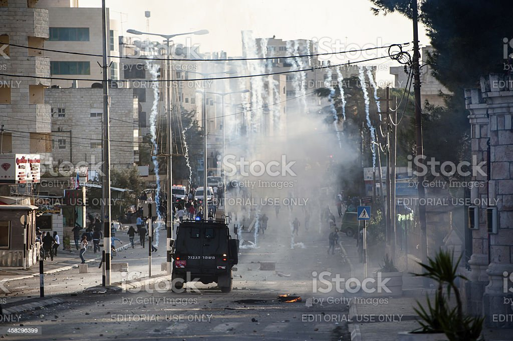 Israeli military occupation, tear gas, in West Bank royalty-free stock photo