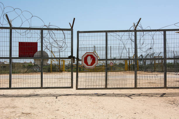 Israeli Palestine border gate check post Israeli Palestine border gate checkpost security barrier stock pictures, royalty-free photos & images