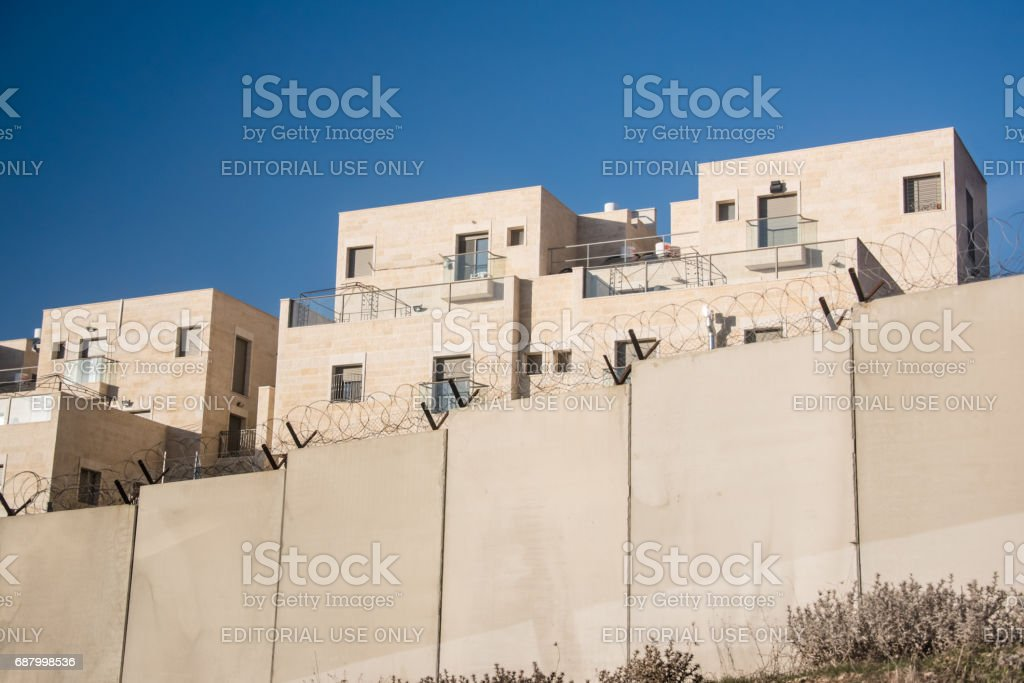 Israeli settlement and separation wall in occupied Palestinian territory stock photo