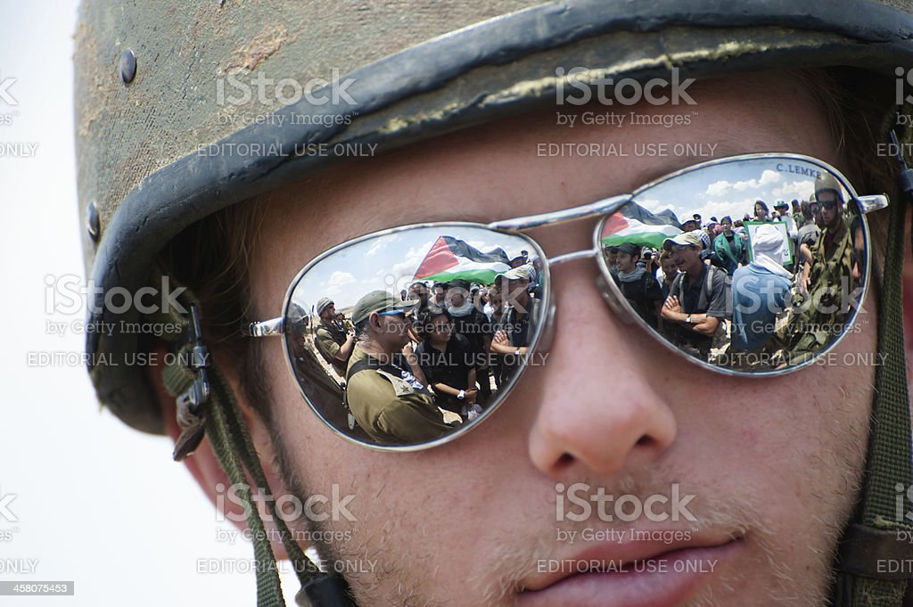Israeli soldier at Palestinian demonstration stock photo