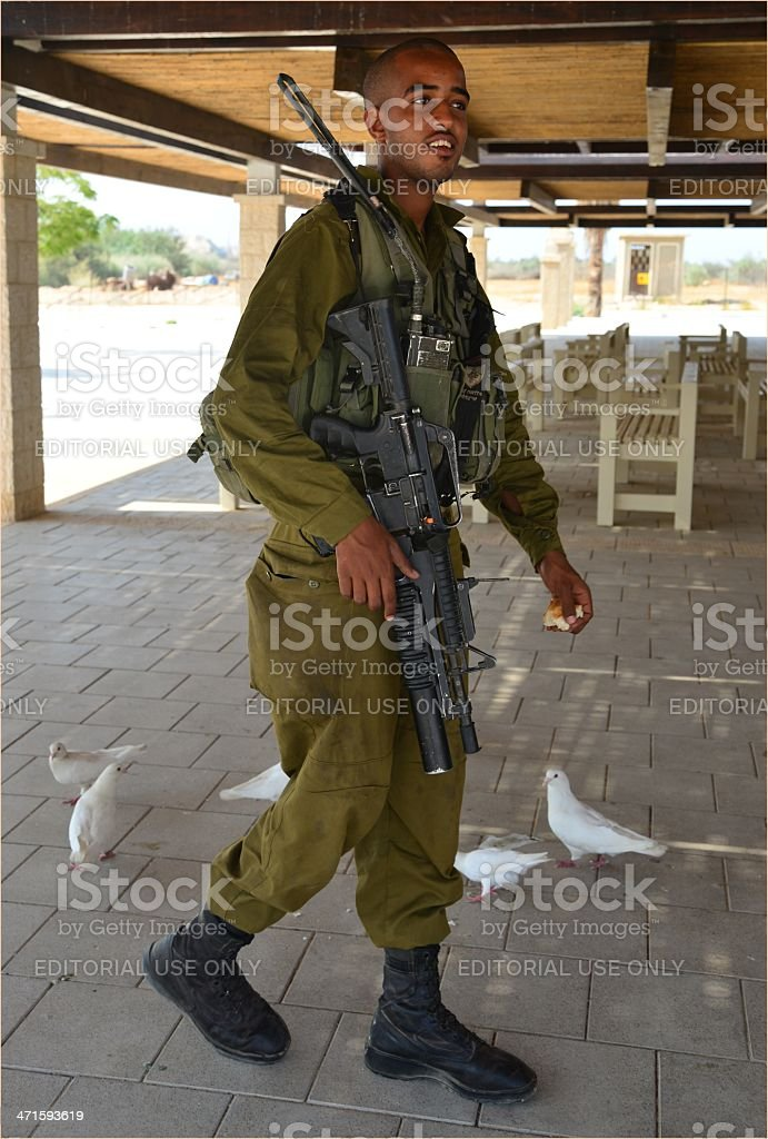 Israeli soldier patrols Baptismal Site on the Jordan River royalty-free stock photo
