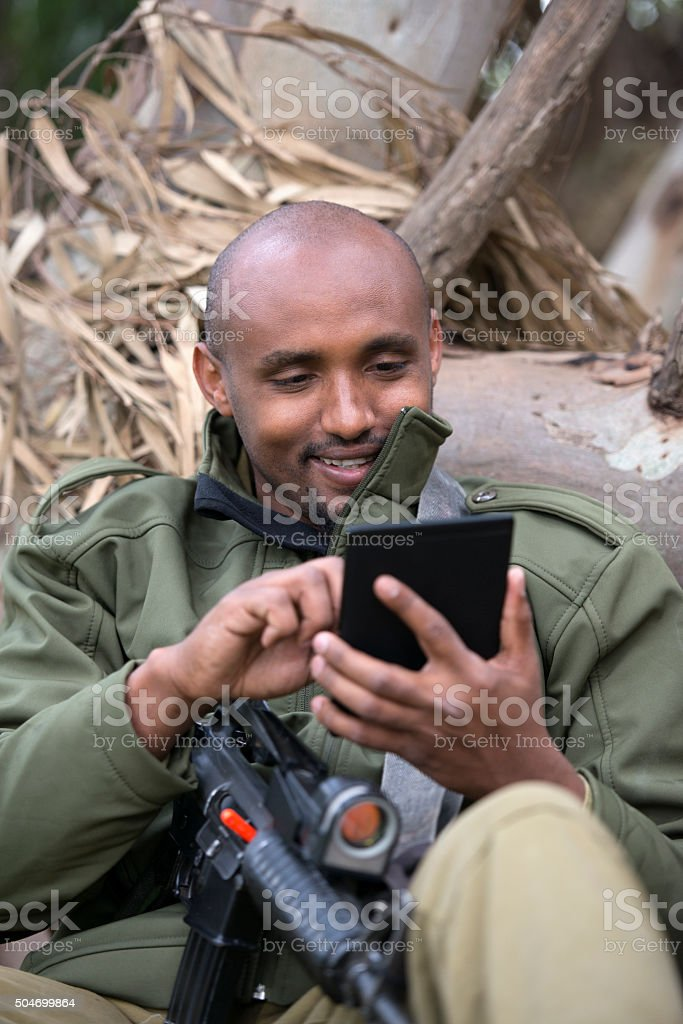 Israeli soldier with digital tablet PC. stock photo