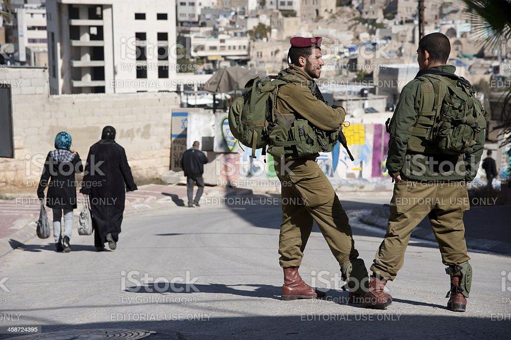 Israeli Soldiers and Hebron Settlement stock photo