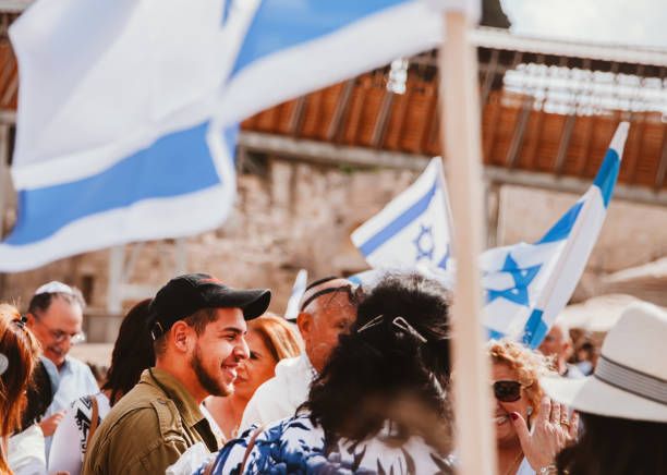 Israeli soldiers in Jerusalem 'East Jerusalem, Wailing Wall,Israel - November 1st, 2016: Israeli soldiers celebrating a group of Israelies for bar mitzvah at the Wailing wall in Jerusalem,Israel. east jerusalem stock pictures, royalty-free photos & images