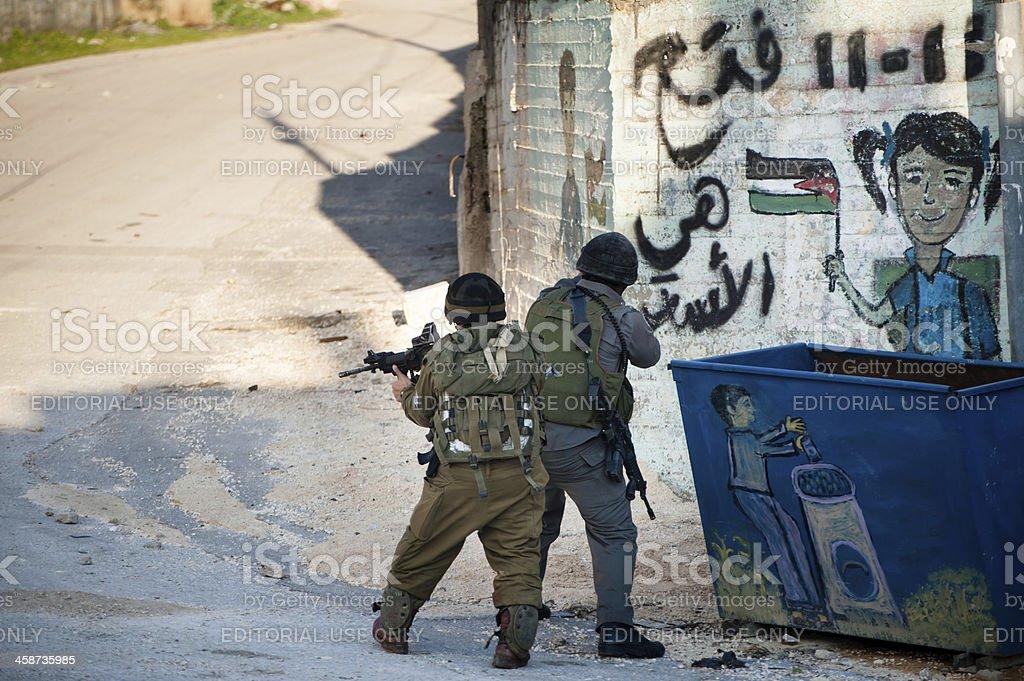 Israeli soldiers invade Palestinian village stock photo