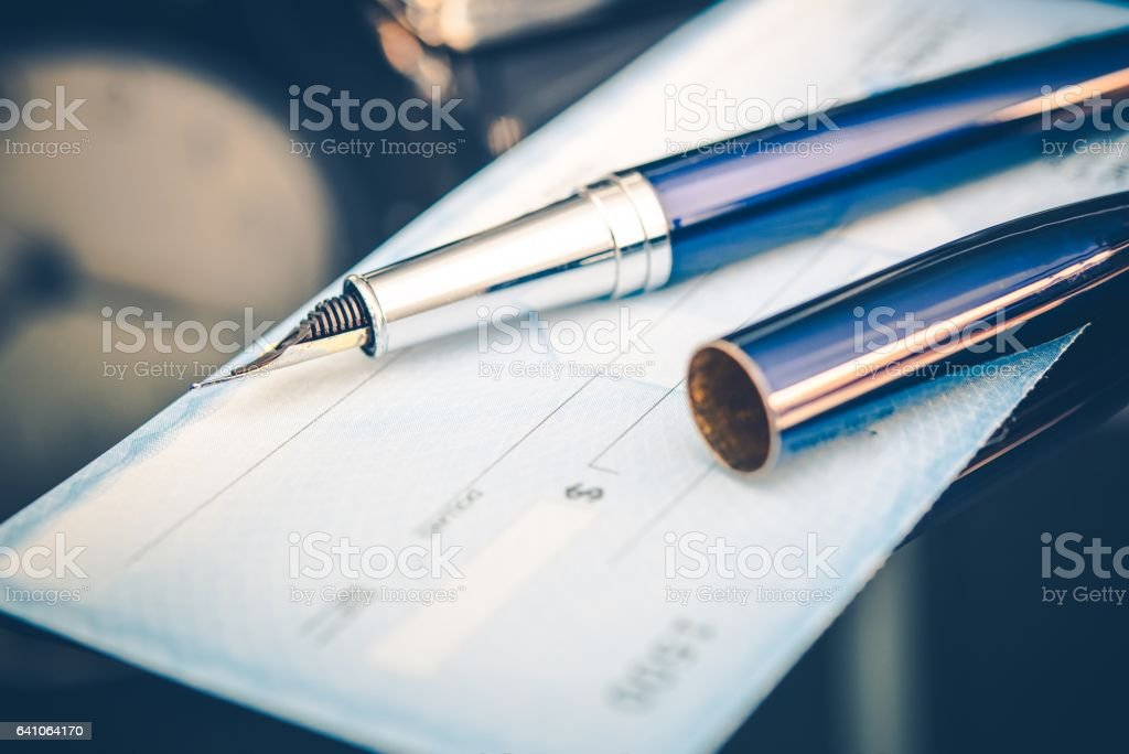 Issuing Payment by Check stock photo