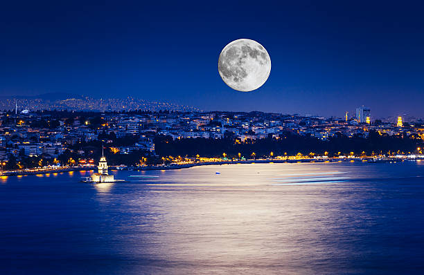 Istanbul at Night with Moon The Maiden's Tower with fullmoon and lights on sea in Istanbul, Turkey bosphorus stock pictures, royalty-free photos & images