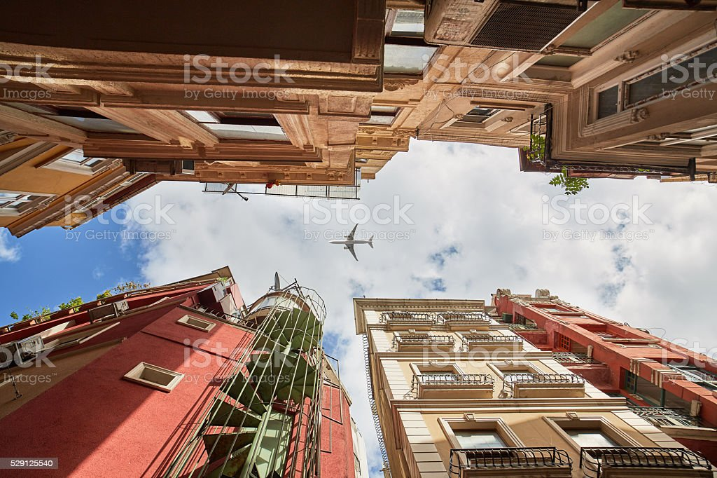 istanbul, beyoğlu old historic building with a airplane silhouette stock photo