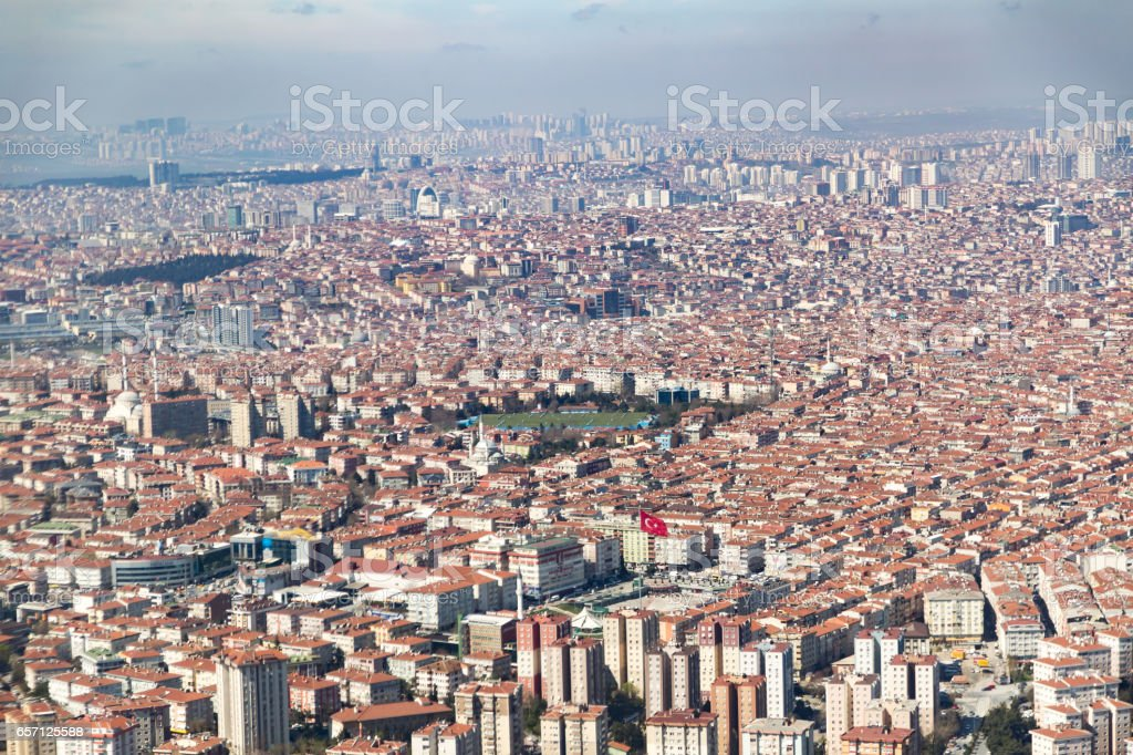 Istanbul big city area with a lot of apartments and turkish flag stock photo