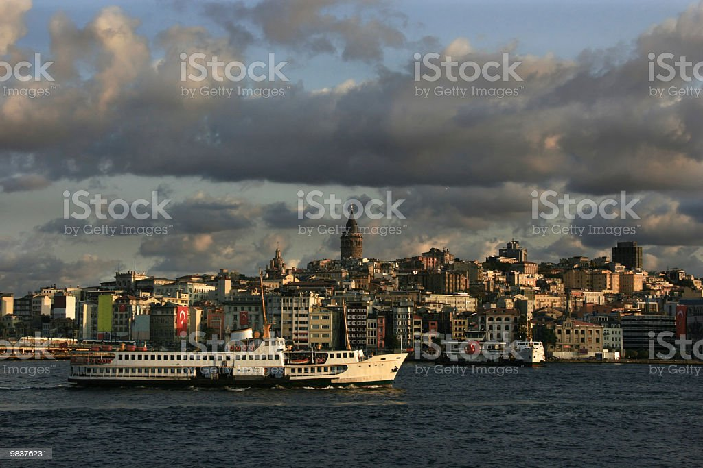 Istanbul cityscape with Galata tower and ferries royalty-free stock photo